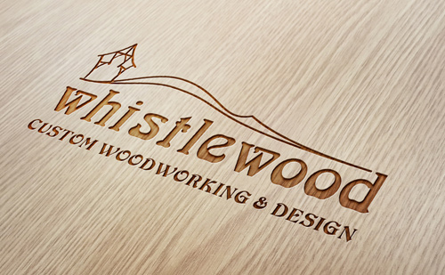 logo for Whistlewood custom woodworking and design